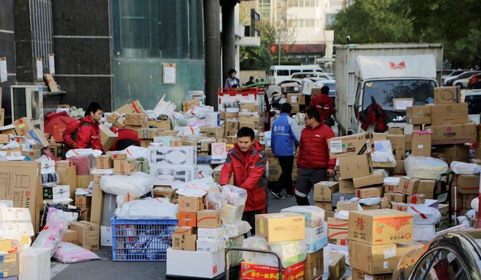 JD.com deliverymen sorting parcels beside a road after last year's 11.11 Singles' Day shopping festival in downtown Beijing on November 12. Photo: Reuters