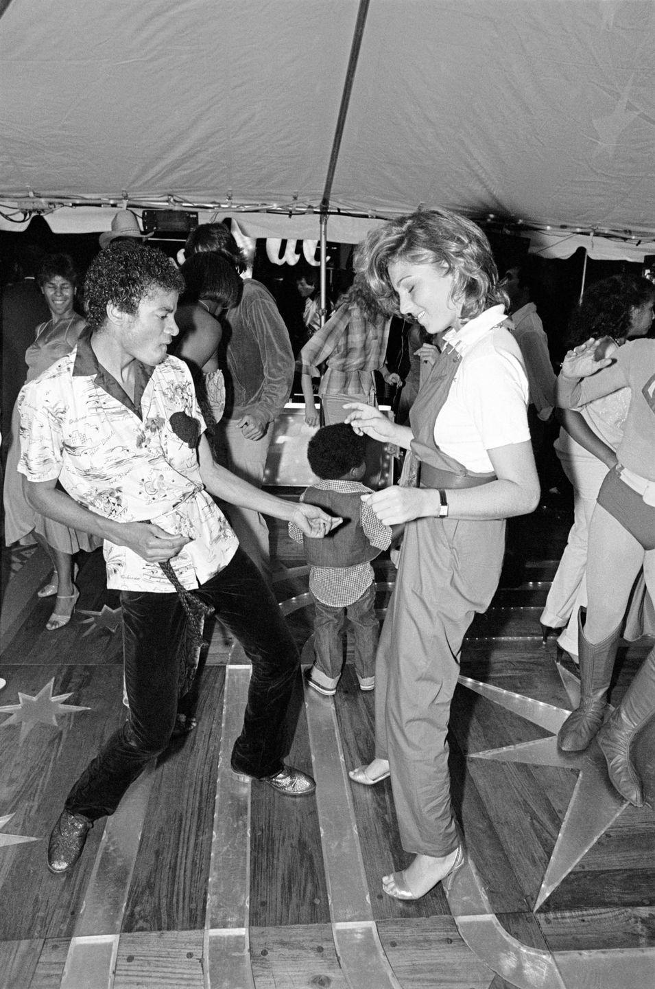 <p>Michael Jackson dances with Tatum O'Neal at a party to celebrate the Jacksons' gold records on June 21, 1979.</p>