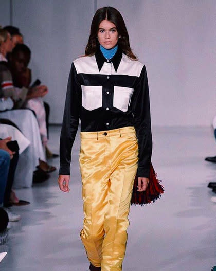 """<p>She's smiling inside! Kaia made her long-awaited runway debut at NYFW on Thursday as she strutted her stuff at the Calvin Klein show. """"CALVIN KLEIN! there are no words to describe how I feel, I love you endlessly Raf!"""" the teen wrote, giving a shout-out to the label's new chief creative officer, Raf Simons. (Photo: <a rel=""""nofollow"""" href=""""https://www.instagram.com/p/BYwtbzZBd8J/?hl=en&taken-by=kaiagerber"""">Kaia Gerber via Instagram</a>) </p>"""