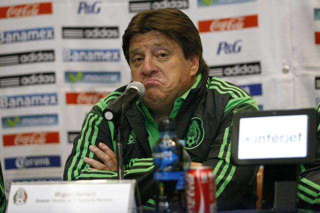 Mexico's coach Miguel Herrera gestures during a news conference after the team's arrival to the Benito Juarez international airport in Mexico City June 30, 2014. Mexico's World Cup roller-coaster came to abrupt end on Sunday when they suffered a heart-breaking loss to the Netherlands in the last 16. The soccer gods, who had smiled on Mexico during their troubled qualifying campaign, finally abandoned El Tri when they were just minutes away from reaching the quarter-finals. REUTERS/Bernardo Montoya (MEXICO - Tags: SPORT SOCCER WORLD CUP)