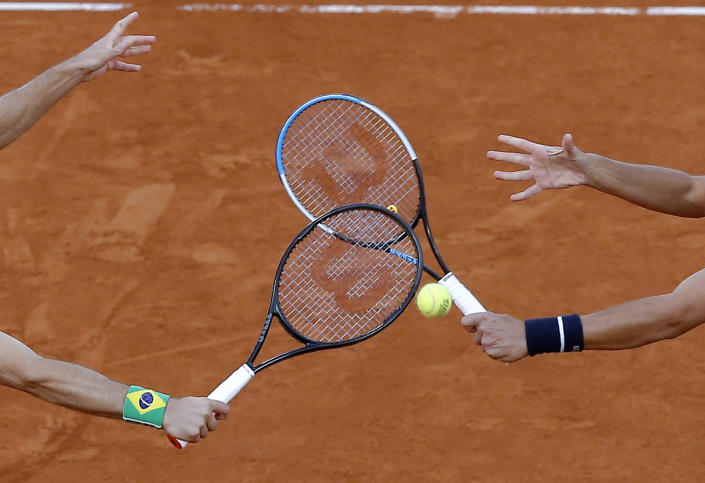 FILE - In this file photo dated Saturday, Oct. 10, 2020, Croatia's Mate Pavic, right, and Brazil's Bruno Soares play a shot in the men's doubles final match of the French Open tennis tournament at the Roland Garros stadium in Paris, France. The 2021 French Open schedule is being disrupted by the coronavirus pandemic for the second year in a row, as organizers said Thursday April 8, 2021, the Grand Slam tournament will be delayed by one week because of surging virus cases in France.(AP Photo/Michel Euler, FILE)