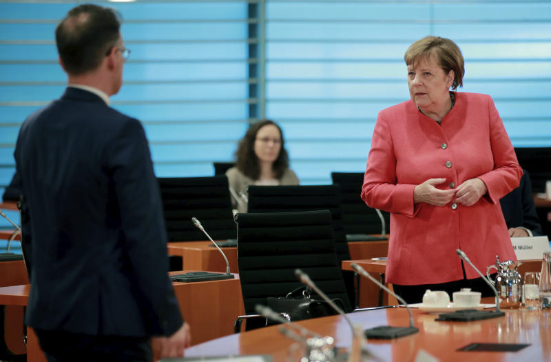 German Chancellor Angela Merkel, right, and German Foreign Minister Heiko Maas, right, attend the weekly cabinet meeting at the chancellery in Berlin, Germany, Wednesday, June 24, 2020. (Hannibal Hanschke/Pool Photo via AP)