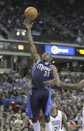 Dallas Mavericks guard Jason Terry (31) goes up for the shot as Sacramento Kings guard Isaiah Thomas, bottom right, looks on during first quarter of an NBA basketball game in Sacramento, Calif., Friday, March 9, 2012. (AP Photo/Rich Pedroncelli)