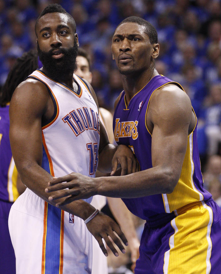 Los Angeles Lakers forward Metta World Peace, left, and Oklahoma City Thunder guard James Harden (13) jockey for position as they wait for the ball to be inbounded during the first quarter of Game 1 in the second round of the NBA basketball playoffs, in Oklahoma City, Monday, May 14, 2012. (AP Photo/Sue Ogrocki)