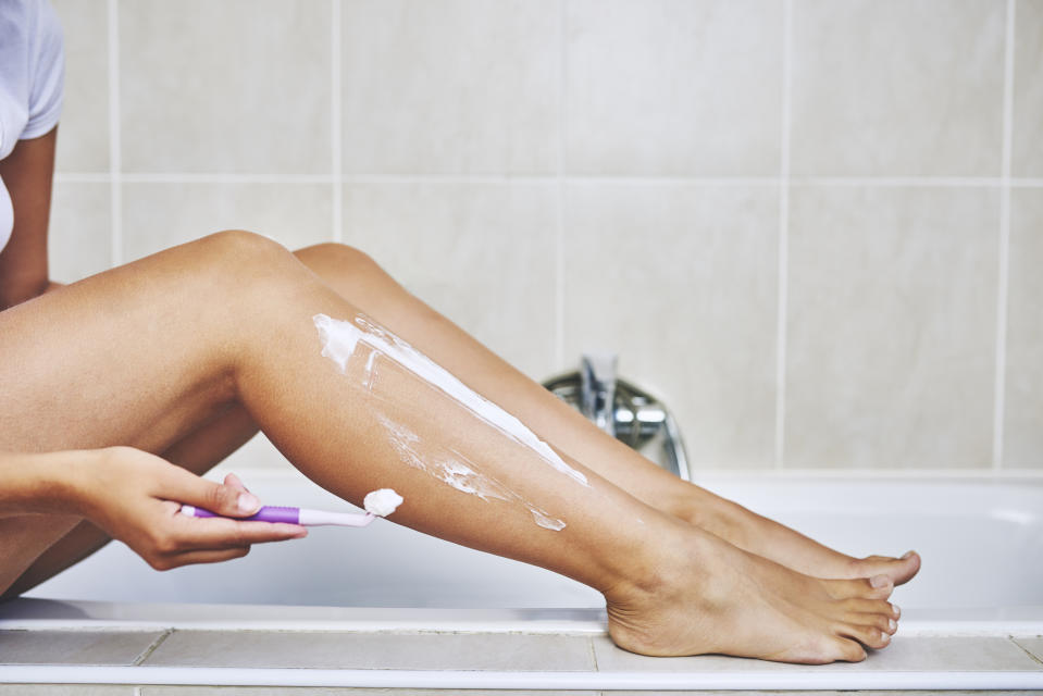 Cropped shot of an unrecognizable woman shaving her legs