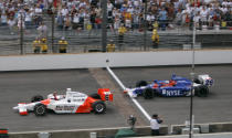FILE - In this May 28, 2006, file photo, Sam Hornish Jr., left, pumps his fist as he beats Marco Andretti to the finish line to win the Indianapolis 500 auto race at Indianapolis Motor Speedway in Indianapolis. The Associated Press has updated its survey of living Indianapolis 500 winners and their pick as the greatest race in the long history of the event. There are six races that received multiple votes, topped by Al Unser Jr.s victory over Scott Goodyear in 1992 the closest Indy 500 in history. The others are Emerson Fittipaldi's win in 1989; Hornish's win in 2006; the 1982 battle between Rick Mears and Gordon Johncock; the 2011 race won by the late Dan Wheldon; and the 2014 thriller won by Ryan Hunter-Reay. (AP Photo/Dave Parker, File)