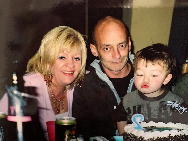 Pictured is Kerry Norton and her second husband Neil with their son Kai as he blows out birthday candles.