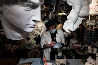 Hamid Seddighi, who makes carnival masks, has seen his revenues plunge 70 percent due to the pandemic
