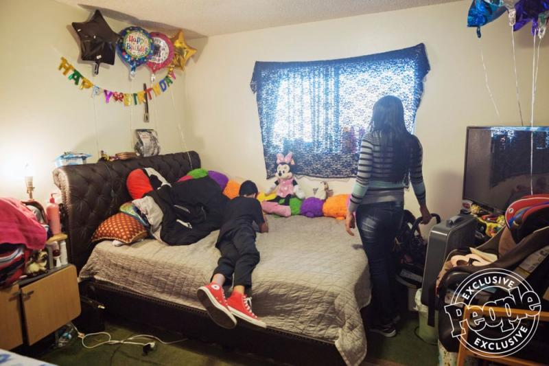 Daniella (right) with her son, Carlos, in his room | Kayla Reefer