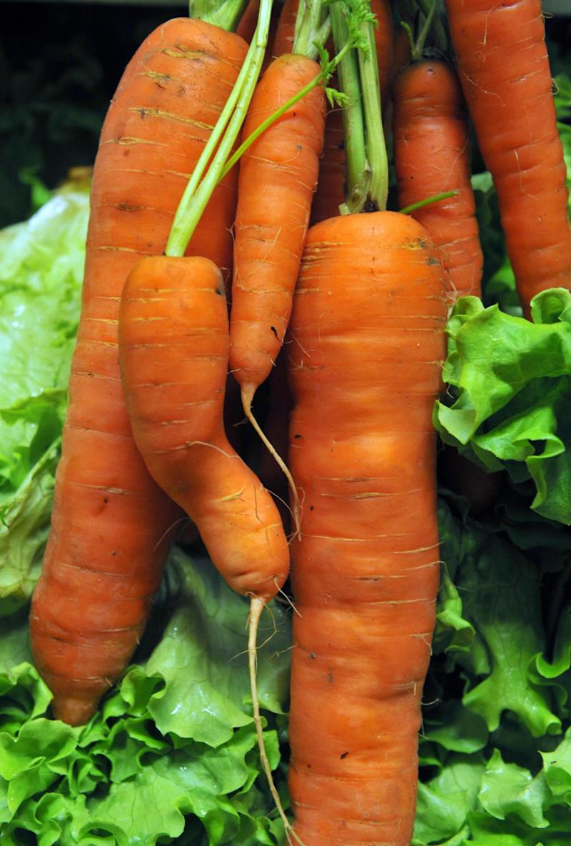 MPs say food waste would be cut if supermarkets started selling more 'wonky veg' (AFP/Getty Images)