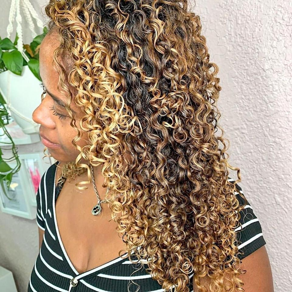 """Dramatic highlights are one of the season's biggest trends, but they particularly pop on curls. """"This color is beautiful on warmer skin tones and is drastic enough to feel like you're really switching up your look,"""" says Powell. """"Dimension is key for this look, so make sure you and your stylist are on the same page about the final color you're looking for. """""""