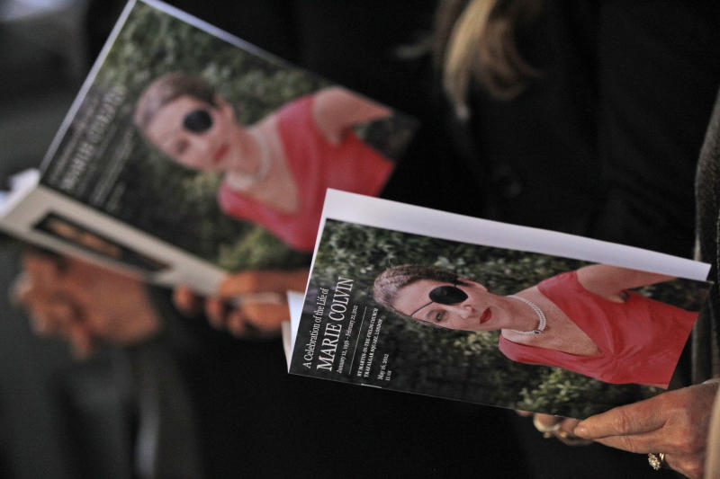 People attend a memorial service for Marie Colvin, the Sunday Times war correspondent who was killed in Homs, Syria on Feb. 22, at St Martin-in-the-Fields church in central London, Wednesday, May 16, 2012. (AP Photo/Lefteris Pitarakis)