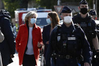 Head of the Ile de France regional council Valerie Pecresse, left, arrives at the Police station in Rambouillet, south west of Paris, Friday, April 23, 2021. A French police officer was stabbed to death inside her police station Friday near the famed historic Rambouillet chateau, and her attacker was shot and killed by officers at the scene, authorities said. The identity and the motive of the assailant were not immediately clear, a national police spokesperson told The Associated Press. The police officer was a 49-year-old administrative employee in the station, the spokesperson said. (AP Photo/Michel Euler)