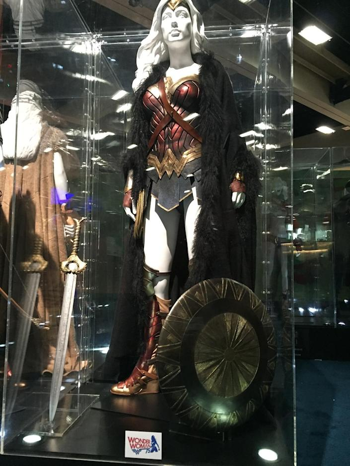 <p>Nearly identical to the costume she wore in <i>BvS</i>, her solo film wardrobe includes sword, shield, golden lasso, tiara, and a fur coat, because, you know, it's cold in WWI Europe. </p>