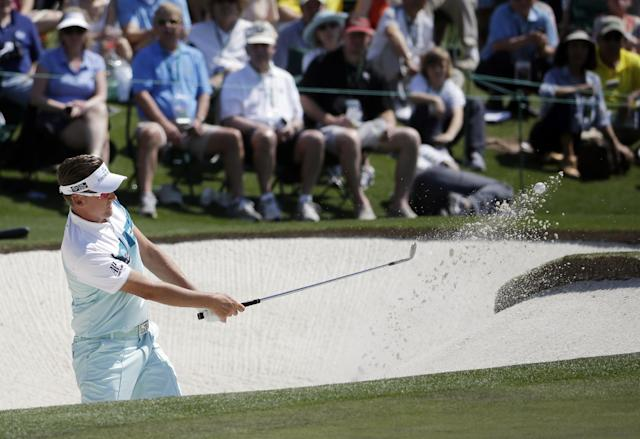 Ian Poulter, of England, hits out of a bunker on the second hole during the third round of the Masters golf tournament Saturday, April 12, 2014, in Augusta, Ga. (AP Photo/Darron Cummings)