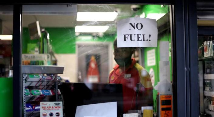 A sign shows customers that fuel has run out at a petrol station