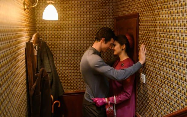 Anthony (Callum Turner) and Jennifer in one of her meticulous outfits, featuring the coat with the stunning back.<p>Photo: Parisa Taghizadeh/Courtesy of Netflix</p>