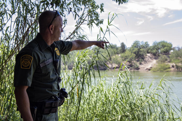 Border Patrol agent Carlos Ruiz points out an area of high traffic along the Rio Grande south of McAllen, Texas. 32 illegal immigrants were found during a sweep of the area in the span of 2 hours. (Photo: Sergio Flores for Yahoo News)