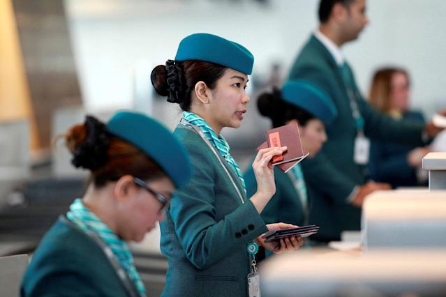 <p>Staff speaks with passengers at Hamad International Airport in Doha, Qatar, June 7, 2017. (Photo: Naseem Zeitoon/Reuters) </p>