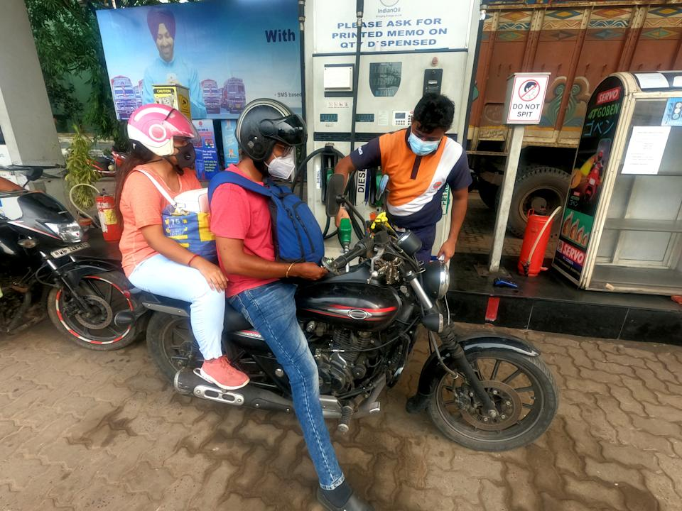 A fuel pump attendant fills a motorbike with petrol at a gas station, as fuel prices continue to rise,Petrol Rs 99.04 per liter. Diesel prices also rose to Rs 92.03 in Kolkata on July 03,2021. (Photo by Debajyoti Chakraborty/NurPhoto via Getty Images)