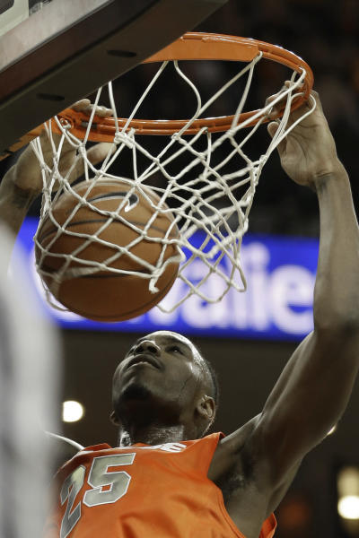 Syracuse forward Rakeem Christmas (25) watches his dunk during the first half of an NCAA College basketball game in Charlottesville, Va., Saturday, March 1, 2014. (AP Photo/Steve Helber)