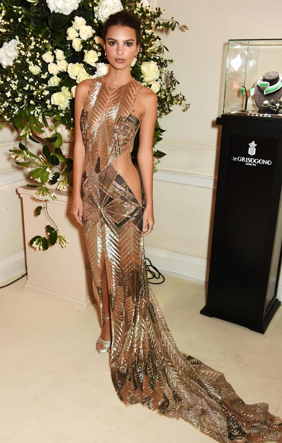 <p>Proving once again she's not afraid of daringly-placed cut-out, Emily donned a silver Julien McDonald dress at a preview of Annabel's Private Club in London. <br>[Photo: Getty] </p>