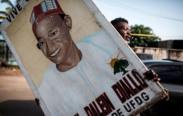 A supporter holds up a painting of main opposition candidate, Cellou Dalein Diallo in Conakry on October 14, 2020.