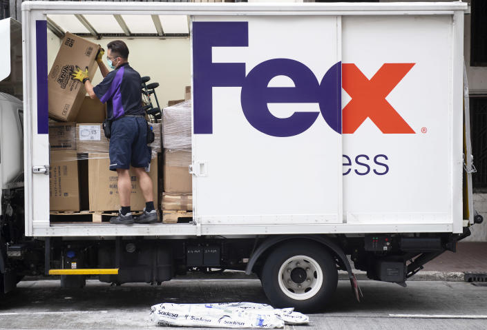 HONG KONG, CHINA - 2020/05/11: A FedEx Express courier prepares the numerous packages inside the delivery truck parked on the street. (Photo by Budrul Chukrut/SOPA Images/LightRocket via Getty Images)