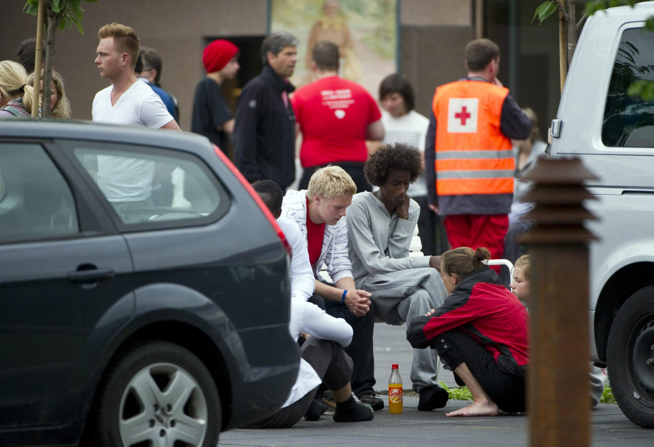 Teenagers who were attending a Labour Party youth wing summer camp on the Utoya island comfort one another outside the Sunvold Hotel, Sundvollen, Norway Saturday July 23, 2011. A Norwegian gunman disguised as a police officer beckoned his victims closer before shooting them one by one, claiming at least 84 lives, in a horrific killing spree on an idyllic island teeming with youths that has left this peaceful Nordic nation in mourning. The island tragedy Friday unfolded hours after a massive explosion ripped through a high-rise building housing the prime minister's office, killing seven people. (AP Photo/Scanpix/Bjern Larsson Rosvall)
