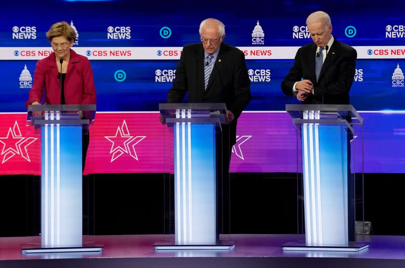 FILE PHOTO: Candidates during pause during a break at the tenth Democratic 2020 presidential debate at the Gaillard Center in Charleston, South Carolina, U.S.