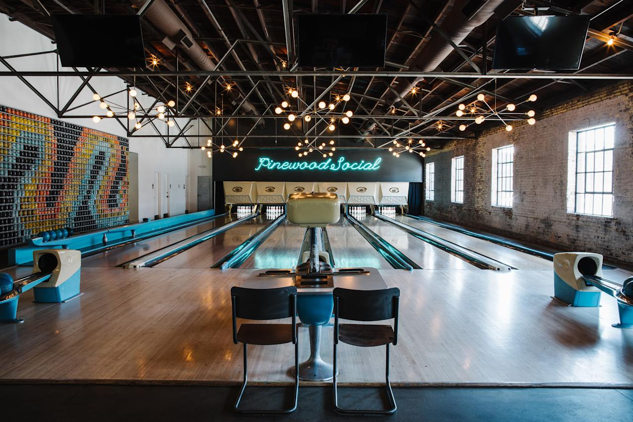 <p><strong>First impression?</strong><br> Pinewood is a hipster-cool hangout for those at work and at play. Young entrepreneurs tap away on their laptops in the Living Room. Restaurant patrons come for Southern comfort food and craft cocktails, followed by karaoke and bowling at the six-lane alley.</p> <p><strong>Cool. So who's there?</strong><br> Although it's more than four years old, Pinewood is still very much a place to see and be seen. Expect plaid-clad young professionals on lunch break. By mid-afternoon, the Living Room quiets down as people race to finish the day's work—and start happy hour early (Pinewood's famous for its Easy Like Sunday Morning, a decadent Crema coffee cocktail).</p> <p><strong>How are the drinks?</strong><br> The restaurant prides itself on mixology, which includes single-barrel spirits and seasonal cocktails. Try the ever-delicious Old Fashioned or whatever variety of a Pimm's Cup the bartender is whipping up that day. There's also a small selection of craft beers on tap, and, during warmer months, an Airstream trailer parked out front serving frozen rosé sangria and tiki-inspired drinks.</p> <p><strong>Worth ordering something to eat, too?</strong><br> Pinewood's menu focuses on elevated Southern cuisine—and playful nomenclature. Don't miss the tahini spread avocado toast or the fried broccoli with lemon zest and sunflower aioli. Other must-eats: the cheeseburger and the meatloaf, a mash-up of beef, pork, mushroom gravy, and potato.</p> <p><strong>Did the staff do you right?</strong><br> Service can sometimes be slow when the place is crowded, but staff are friendly and knowledgeable.</p> <p><strong>Wrap it up: what are we coming here for?</strong><br> Pinewood is best for a meal shared among friends. While the moody, nighttime atmosphere lends itself to date nights, the volume level is often too loud for a pair of people trying to get to know each other.</p>