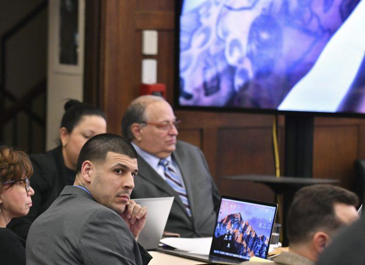 Aaron Hernandez looks at the prosecution during his double-murder trial. (AP)
