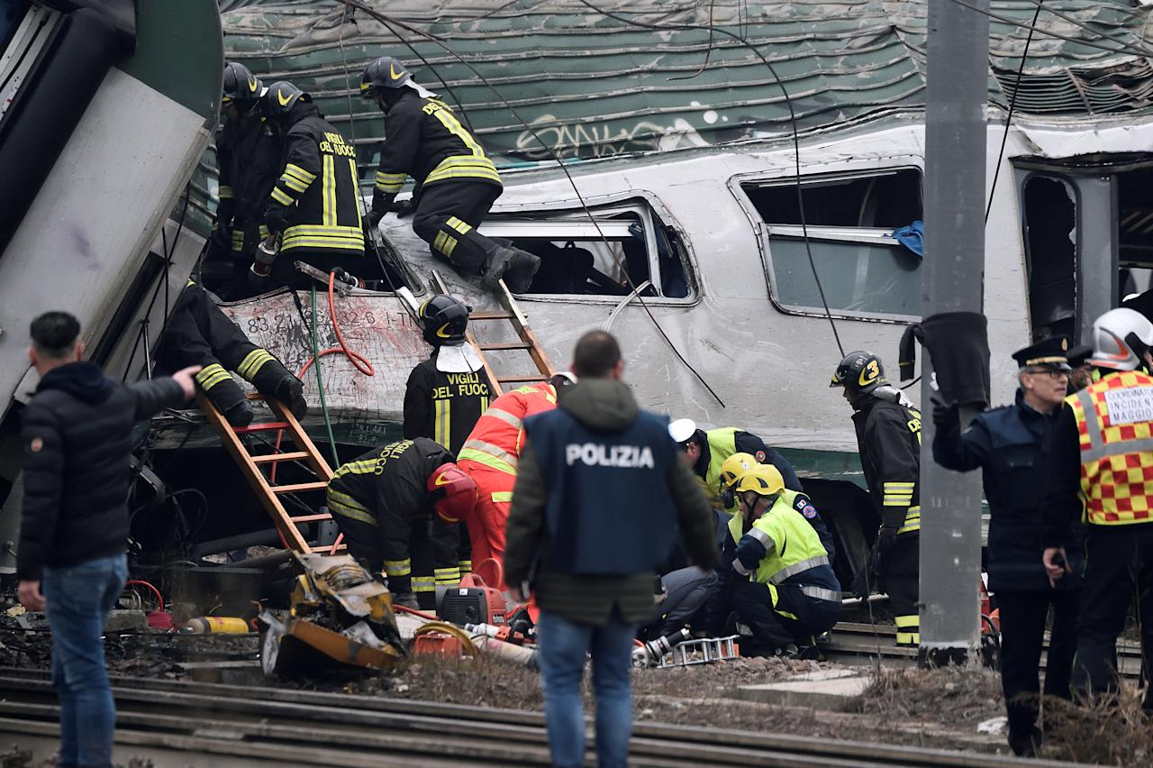 <p>Fire fighters and police officers work around derailed trains in Pioltello, on the outskirts of Milan, Italy, Jan. 25, 2018. (Photo: Stringer/Reuters) </p>