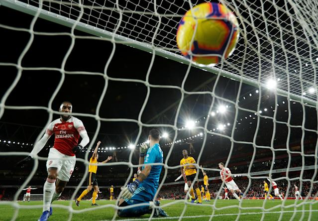"""Soccer Football - Premier League - Arsenal v Wolverhampton Wanderers - Emirates Stadium, London, Britain - November 11, 2018 Arsenal's Alexandre Lacazette retrieves the ball after teammate Henrikh Mkhitaryan scores their first goal Action Images via Reuters/John Sibley EDITORIAL USE ONLY. No use with unauthorized audio, video, data, fixture lists, club/league logos or """"live"""" services. Online in-match use limited to 75 images, no video emulation. No use in betting, games or single club/league/player publications. Please contact your account representative for further details."""