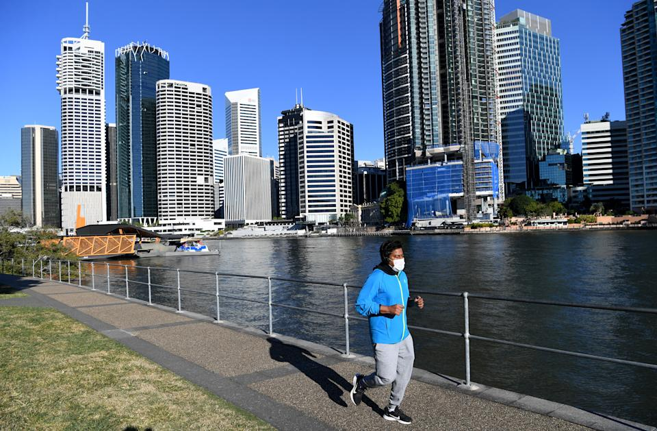 A man is seen exercising at Kangaroo Point in Brisbane on Thursday. Source: AAP