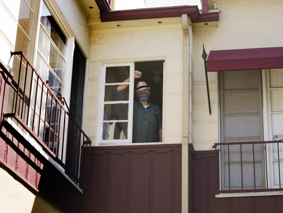 Nathan Long, a video game writer, stands inside his rental apartment in Glendale, Calif., Thursday, April 8, 2021. He and his wife, Lili, have been unsuccessful so far in their search for a home in Los Angeles. (AP Photo/Damian Dovarganes)