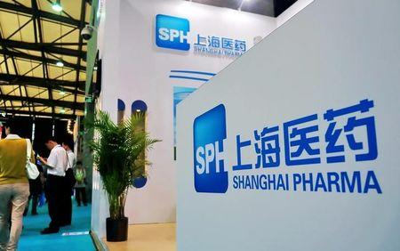 FILE PHOTO: A stand of Shanghai Pharmaceutical Holding Co Ltd is seen at a medicine exhibition in Shanghai, China June 26, 2012.  REUTERS/Stringer