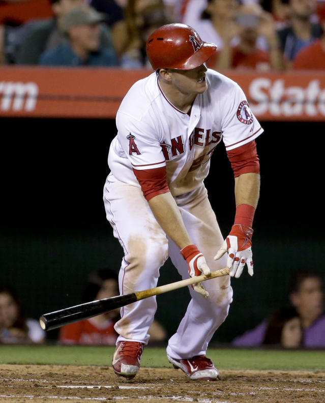 Los Angeles Angels' Mike Trout watches his RBI double against the Miami Marlins during the fourth inning of a baseball game in Anaheim, Calif., Tuesday, Aug. 26, 2014. (AP Photo/Chris Carlson)