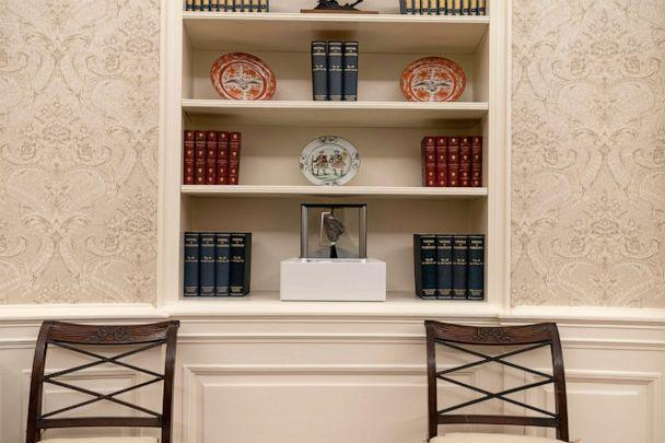 PHOTO: The Oval Office is newly decorated, Jan. 20, 2021, with a rock from the moon on the center shelf. (Alex Brandon/AP)