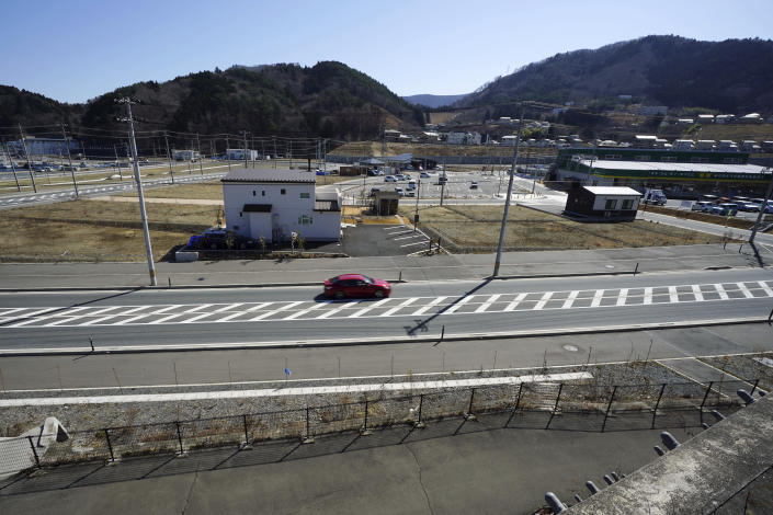 Ten years after the disaster, some of new buildings stand sparsely are seen in the tsunami and earthquake destroyed town of Onagawa, Miyagi Prefecture, northern Japan. Thursday, March 4, 2021. (AP Photo/Eugene Hoshiko)