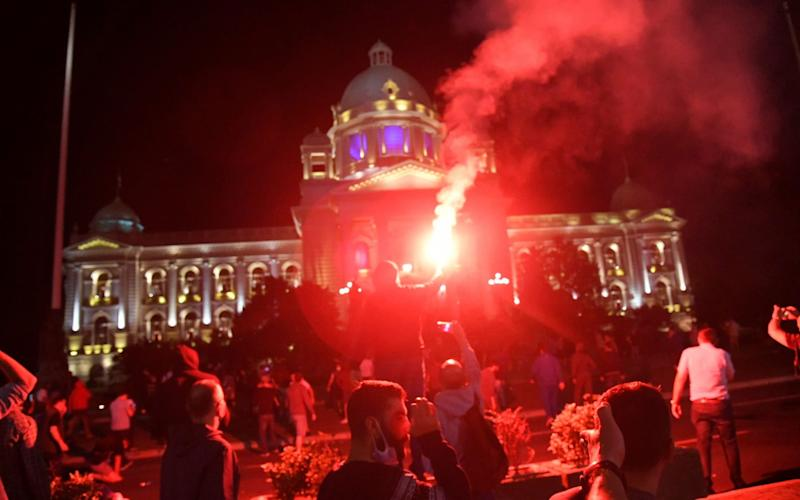 Protesters gather in front of the Serbian Parliament in Belgrade on Tuesday before violent clashes broke out with police. - ANDREJ CUKIC/EPA-EFE/Shutterstock/Shutterstock