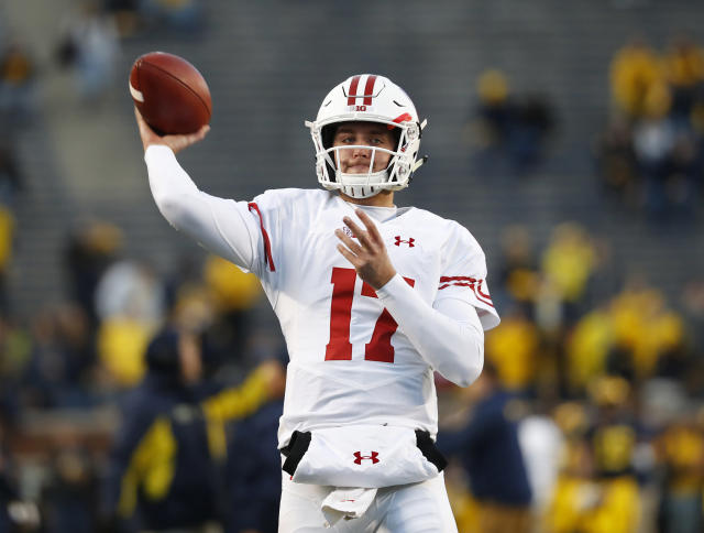 FILE - In this Oct. 13, 2018, file photo, Wisconsin quarterback Jack Coan throws before an NCAA college football game against Michigan, in Ann Arbor, Mich. Four scholarship quarterbacks are competing for the starters job at Wisconsin. Coan is the only quarterback with significant experience following the departure of three-year starter Alex Hornibrook, who went to Florida State as a graduate transfer. (AP Photo/Paul Sancya, File)