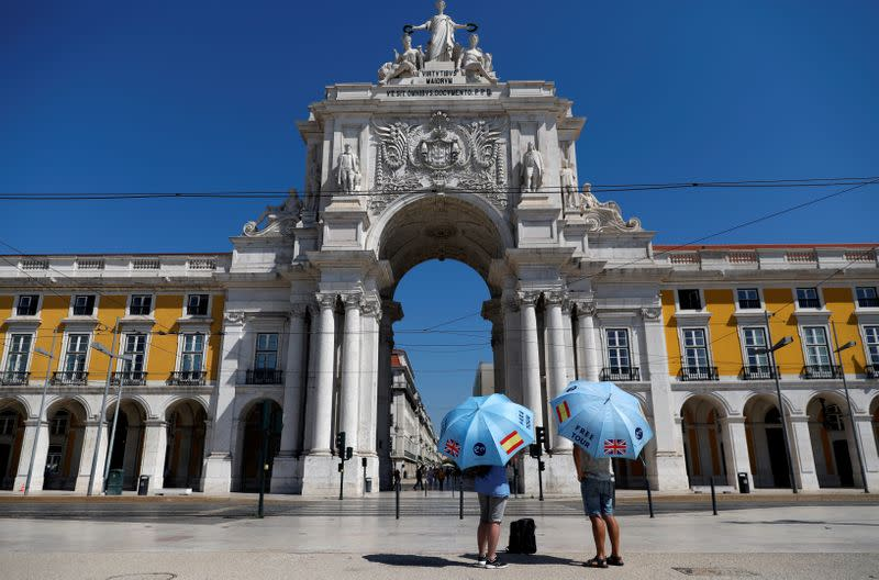 FILE PHOTO: Tour guides await customers during the coronavirus disease (COVID-19) outbreak in Lisbon, Portugal