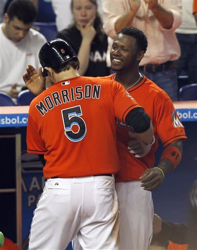 Miami Marlins' Logan Morrison (5) is congratulated by Hanley Ramirez (2) after hitting a home run against the Washington Nationals during a baseball game at Marlins Park in Miami, Monday, May 28, 2012. The Marlins won 5-3. (AP Photo/Joel Auerbach)