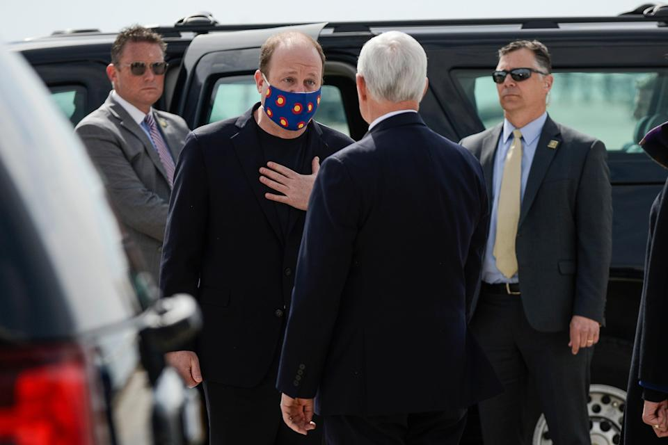 "<h1 class=""title"">Colorado Governor Jared Polis, a Democrat, speaks with Vice President Mike Pence in mid-April. Photo by Michael Ciaglo/Getty Images.</h1> <div class=""caption""> Colorado Governor Jared Polis, a Democrat, wears a mask while speaking with a mask-free Vice President Mike Pence in mid-April. Photo by Michael Ciaglo/Getty Images. </div> <cite class=""credit"">Michael Ciaglo</cite>"