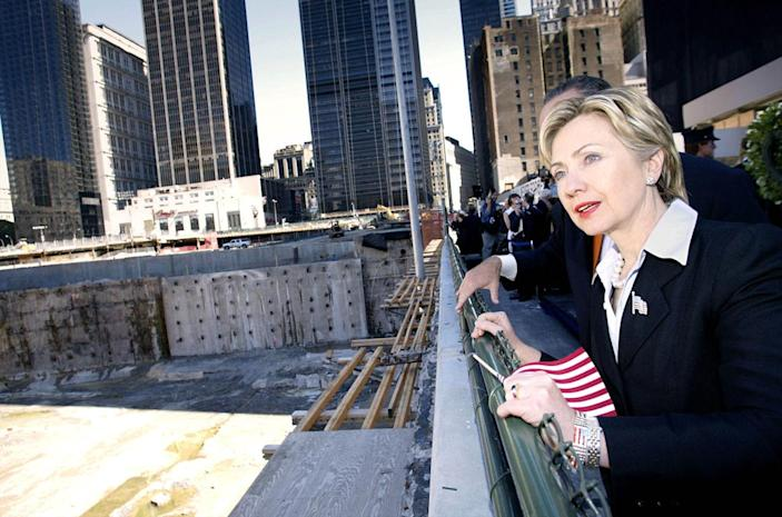 <p>Sen. Hillary Clinton looks over ground zero in New York City, where the World Trade Center Towers collapsed, prior to the wreath laying ceremony in September 2002 by leadership from the U.S. Congress. (Photo: Stephen Jaffe/AP)</p>