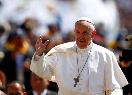 Pope Francis waves as he arrives to lead special audience for Catholic Action members in St. Peter's Square at the Vatican