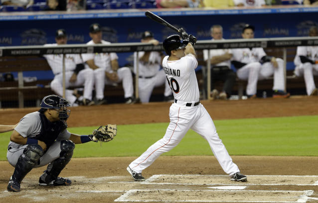 Miami Marlins' Justin Ruggiano (20) follows through on a base hit against the Detroit Tigers in the first inning of an interleague baseball game on Sunday, Sept. 29, 2013, in Miami. (AP Photo/Alan Diaz)