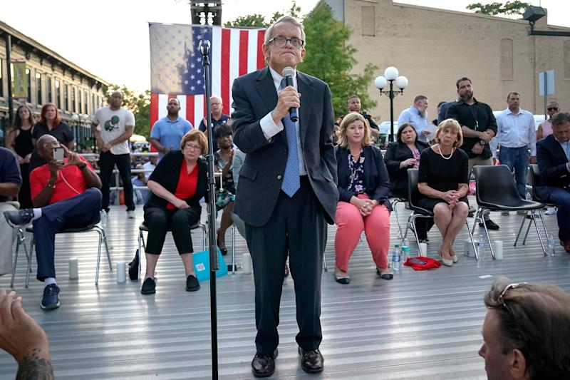 "Ohio Governor Mike DeWine reacts as vigil attendees shout ""Do Something"" while he was speaking at a vigil at the scene after a mass shooting in Dayton, Ohio on August 4, 2019. (Photo: Bryan Woolston/Reuters)"