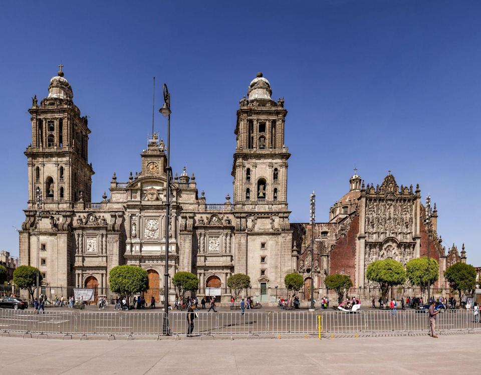 <p>The Metropolitan Cathedral is Latin America's oldest and largest cathedral, and its unique design was inspired by Mexico's indigenous and colonial influences. Its famous Altar of the Kings is the oldest-known example of Churrigueresque—Mexican Gothic—and its exterior was built by stones taken from Aztec temples. It houses the Roman Catholic Archdiocese of Mexico today and is one of the capital city's most popular landmarks. </p>
